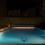 The Swimming pool floodlit at night