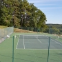The Tennis Court, with a practice wall at its near end.